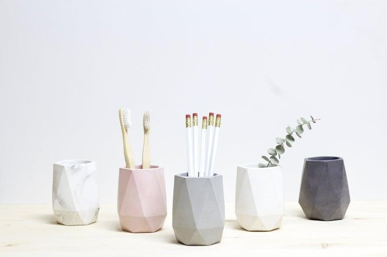 <p>The <span>Geometric Concrete Makeup Brush Holder</span> ($32, and up) is minimalistic and chic. Sort out your makeup brushes by function or size with these.</p>