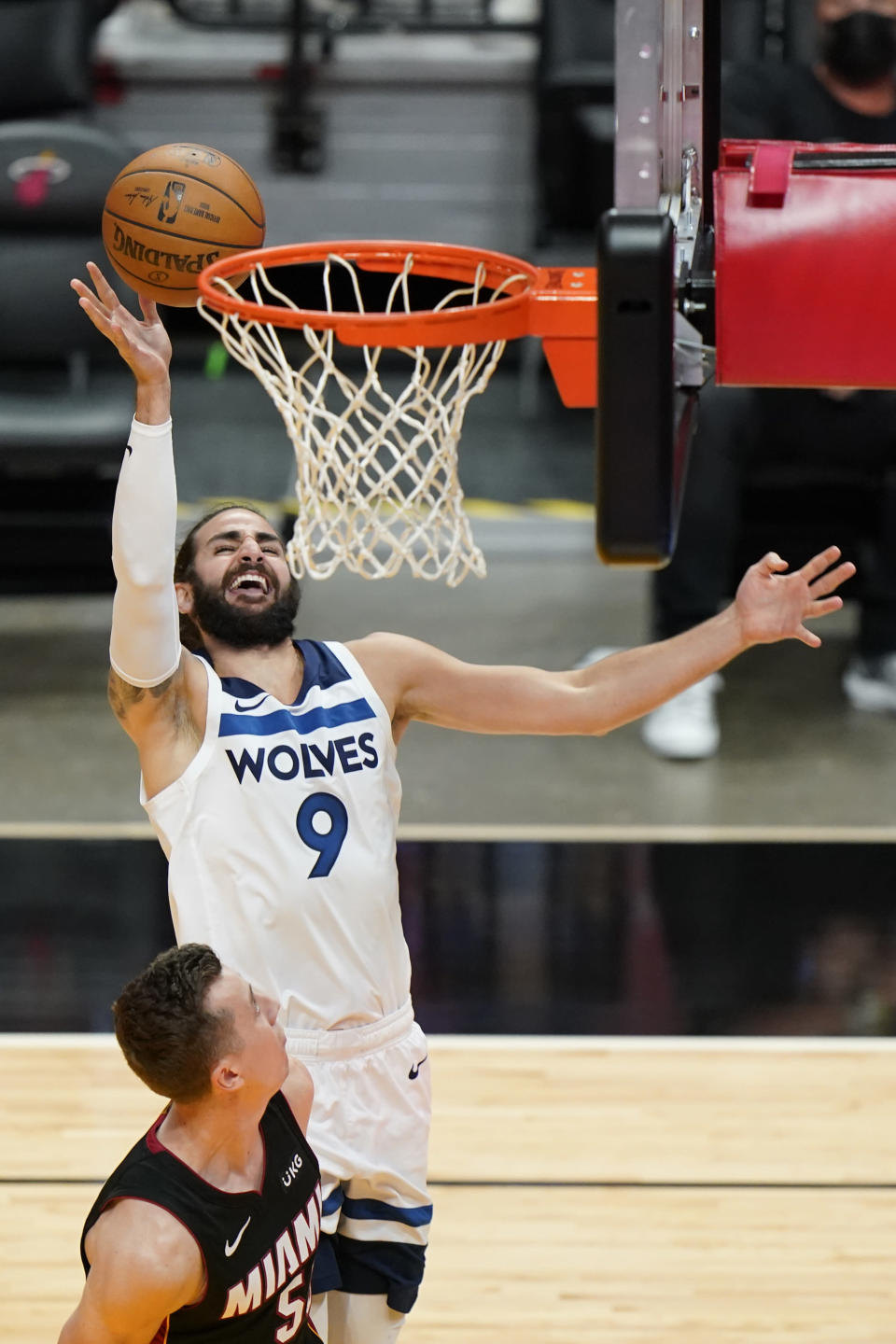 Minnesota Timberwolves guard Ricky Rubio (9) goes up to shoot against Miami Heat forward Duncan Robinson (55) during the first half of an NBA basketball game, Friday, May 7, 2021, in Miami. (AP Photo/Wilfredo Lee)