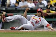 St. Louis Cardinals' Carlos Beltran scores on a single by Matt Holliday off Pittsburgh Pirates starting pitcher Jeff Locke during the first inning of a baseball game in Pittsburgh on Wednesday, July 31, 2013. (AP Photo/Gene J. Puskar)