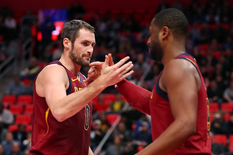 Kevin Love of the Cleveland Cavaliers celebrates a first half basket with Dwyane Wade against the Detroit Pistons (AFP Photo/Gregory Shamus)