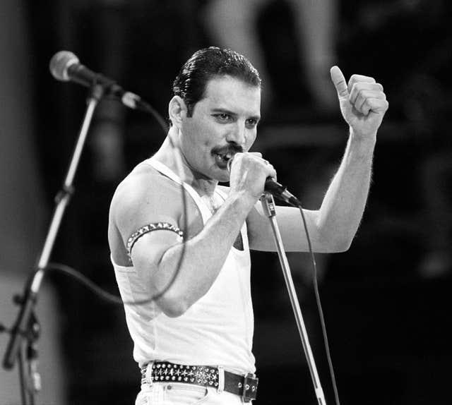 Freddie Mercury performing on stage during the Live Aid concert in 1985