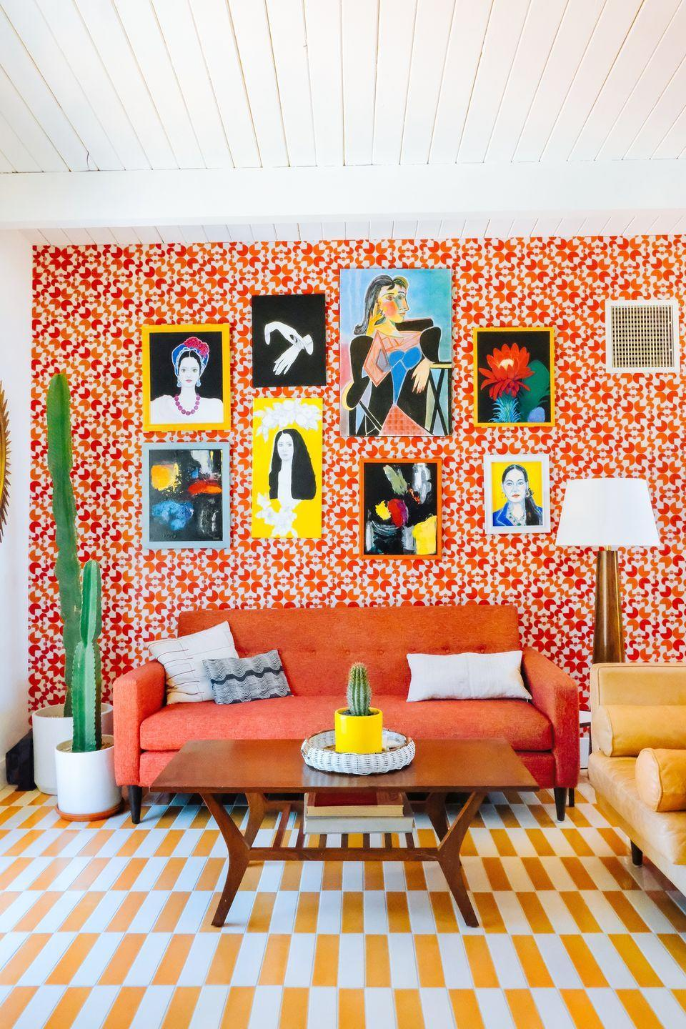 """<p><a href=""""https://www.dazeyden.com/"""" rel=""""nofollow noopener"""" target=""""_blank"""" data-ylk=""""slk:Dazey Den"""" class=""""link rapid-noclick-resp"""">Dazey Den</a>'s Danielle Nagel embraces her eclectic side with a colorful mosaic wallpaper from Hygge & West. A vibrant gallery wall, a yellow patterned rug, and a lamp from <a href=""""https://www.hvlgroup.com/Product/L1443-AGB"""" rel=""""nofollow noopener"""" target=""""_blank"""" data-ylk=""""slk:Hudson Valley Lighting"""" class=""""link rapid-noclick-resp"""">Hudson Valley Lighting</a> round out the look, creating a space that's unapologetically bold.</p><p><em>Arcade Wallpaper, $195</em><br><a class=""""link rapid-noclick-resp"""" href=""""https://www.hyggeandwest.com/products/arcade-cayenne"""" rel=""""nofollow noopener"""" target=""""_blank"""" data-ylk=""""slk:Shop the Look"""">Shop the Look</a></p>"""