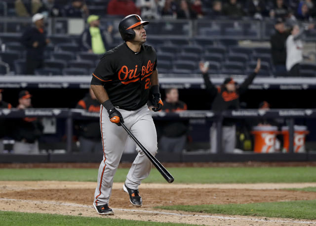 Baltimore Orioles' Pedro Alvarez heads to first after hitting a grand slam against the New York Yankees in the 14th inning of a baseball game early Saturday, April 7, 2018, in New York. (AP Photo/Julie Jacobson)
