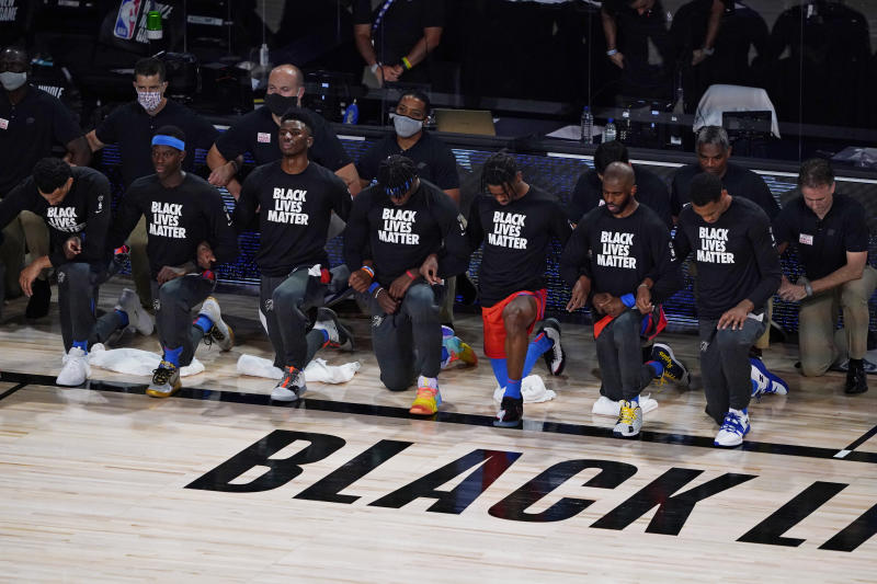 Thunder players kneel before Saturday's game against the Jazz. (AP Photo/Ashley Landis, Pool)