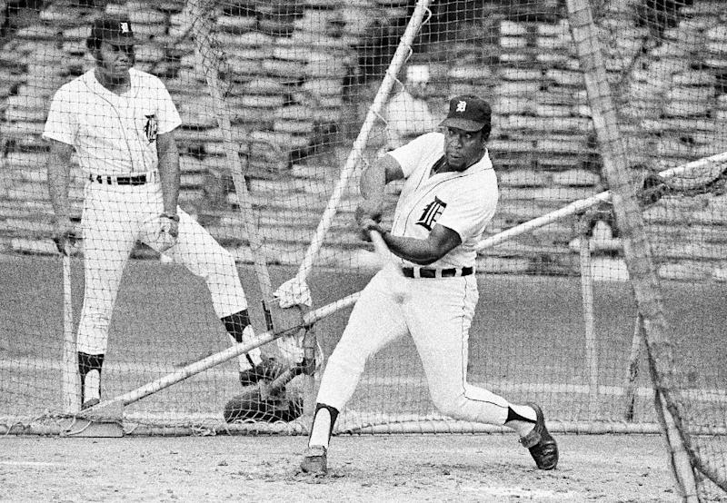 FILE - In this June 20, 1975, file photo, Detroit Tiger's Gates Brown, right, takes batting practice prior as baseman Jack Pierce watches before a baseball game against the New York Yankees in Detroit. Brown, who played his entire 13-year major league career with the Tigers, has died, the team confirmed on Friday, Sept. 27, 2013. He was 74. (AP Photo/John C. Hillery, File)