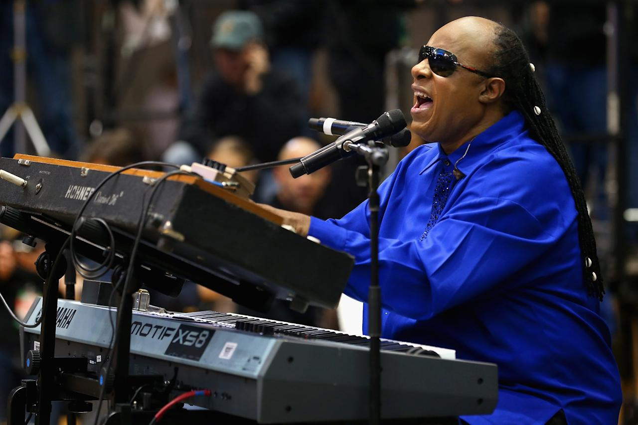 """CINCINNATI, OH - NOVEMBER 04: Stevie Wonder warms up the crowd during a campaign rally for President Barack Obama at Fifth Third Arena November 4, 2012 in Cincinnati, Ohio. With only two days left in the presidential election, Obama and his opponent, former Massachusetts Gov. Mitt Romney are stumping from one """"swing state"""" to the next in a last-minute rush to persuade undecided voters. (Photo by Chip Somodevilla/Getty Images)"""