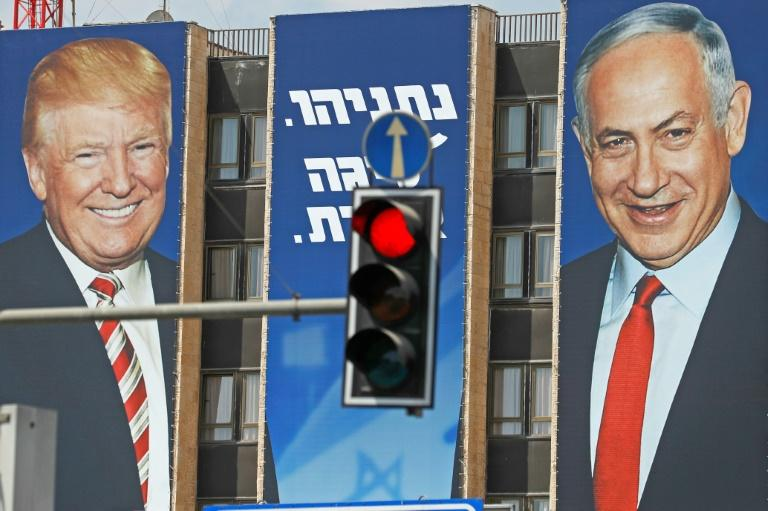 An Israeli election banner bears the portraits of US President Donald Trump (L) and Prime Minister Benjamin Netanyahu hanging on a building facade in Jerusalem