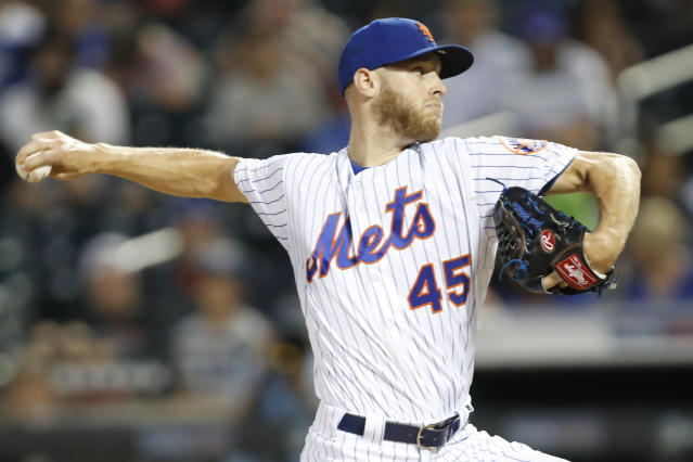 New York Mets starting pitcher Zack Wheeler (45) winds up during the first inning of a baseball game against the Los Angeles Dodgers, Sunday, Sept. 15, 2019, in New York. (AP Photo/Kathy Willens)