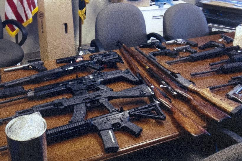 """This undated handout photo provided by the Prince George's, Md. County Police shows weapons found in the possession of a suspect who they say was plotting a shooting in his workplace. Police in Maryland say a man who called himself """"a joker"""" and threatened to shoot up his workplace was in the process of being fired. Police say the 28-year-old man was taken into custody Friday morning. Investigators said he was wearing a T-shirt that said """"Guns don't kill people. I do."""" He was taken into custody for an emergency mental health evaluation and charges are pending. (AP Photo/Prince George's County Police)"""
