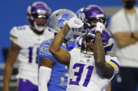 Minnesota Vikings running back Ameer Abdullah reacts after his 4-yard reception for a touchdown during the first half of an NFL football game against the Detroit Lions, Sunday, Jan. 3, 2021, in Detroit. (AP Photo/Al Goldis)