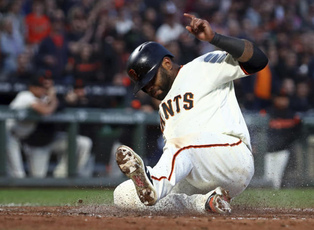 San Francisco Giants' Pablo Sandoval scores against the San Diego Padres during the fifth inning of a baseball game Thursday, June 21, 2018, in San Francisco. (AP Photo/Ben Margot)
