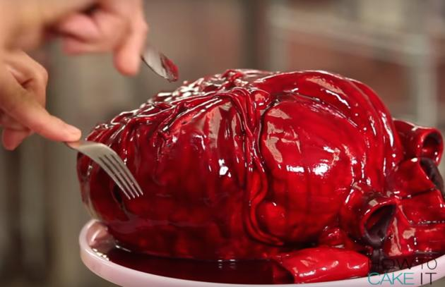"""<p>Clever cake baker extraordinaire Yolanda Gampp of <a href=""""https://www.youtube.com/channel/UCvM1hVcRJmVWDtATYarC0KA"""">How to Cake It</a> has come up with this eerie confection that is <i>not</i> for the faint of heart, but perfect for the horror lovers and heart surgeons among us. Click through for a brief breakdown of how to make it, or for more detailed information, <a href=""""https://www.youtube.com/channel/UCvM1hVcRJmVWDtATYarC0KA"""">watch the video</a>. <i>(Photo:How to Cake It)</i><br /></p>"""