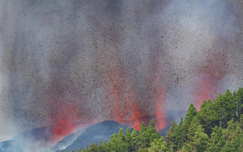 Lava and smoke rise following the eruption of a volcano in the Cumbre Vieja national park - Borja Suarez/REUTERS