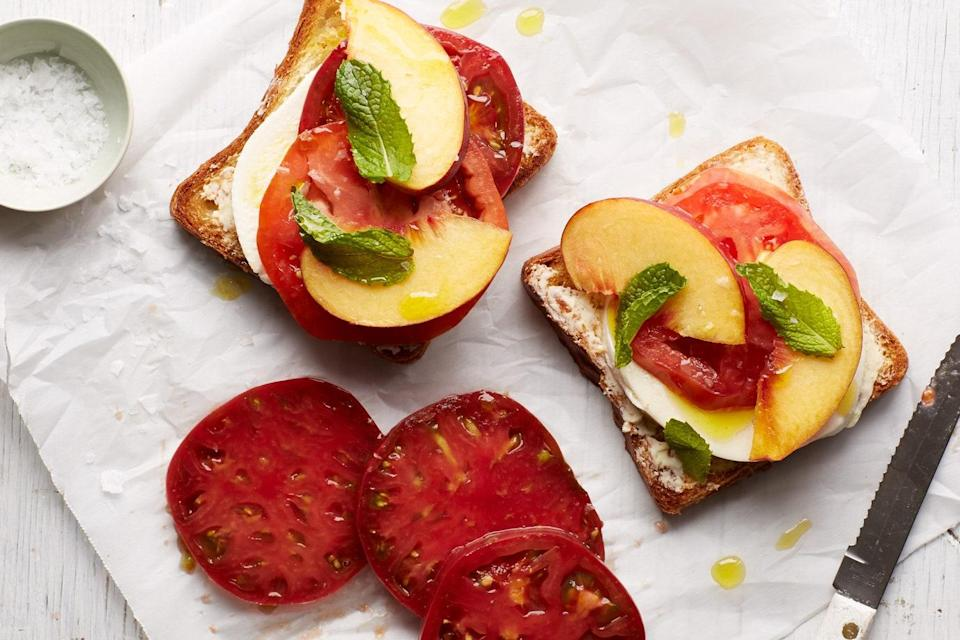 """Some of the best peach recipes are the easiest—and that's certainly the case for this light, flavorful, exceptionally seasonal summer lunch, one of the best ways to use peaches and tomatoes when they're at their absolute peak. <a href=""""https://www.epicurious.com/recipes/food/views/tomato-toast-with-peaches-mozzarella-and-mint-56389822?mbid=synd_yahoo_rss"""" rel=""""nofollow noopener"""" target=""""_blank"""" data-ylk=""""slk:See recipe."""" class=""""link rapid-noclick-resp"""">See recipe.</a>"""