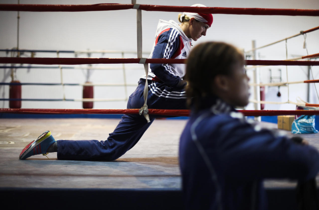British boxer Amanda Coulson (L) practices next to her teammate Natasha Jonas at the Santo Amaro club in Sao Paulo February 9, 2012. The women's boxing team from Great Britain is in Brazil to train with the Brazilian team between January 29 and February 12. According to the team, this exchange of experience with the South American boxers is part of their strategy for the London Olympics 2012, where women's boxing will be making its Olympic debut. Picture taken February 9, 2012. REUTERS/Fernando Donasci