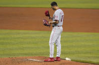 Philadelphia Phillies starting pitcher Vince Velasquez adjusts his cap during the third inning of a baseball game against the Miami Marlins, Monday, Sept. 14, 2020, in Miami. (AP Photo/Lynne Sladky)