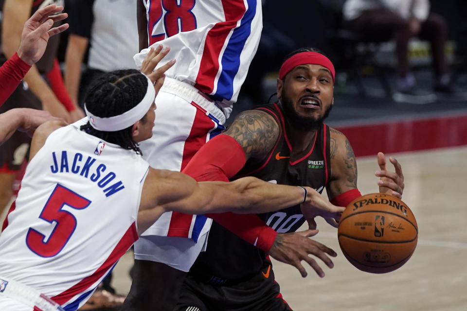 Portland Trail Blazers forward Carmelo Anthony is fouled by Detroit Pistons center Isaiah Stewart (28) as Detroit Pistons guard Frank Jackson (5) knocks the ball away during the first half of an NBA basketball game, Wednesday, March 31, 2021, in Detroit. (AP Photo/Carlos Osorio)