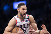 FILE - Philadelphia 76ers guard Ben Simmons reacts after grabbing a rebound during the second half of an NBA basketball game against the Brooklyn Nets in New York, in this Monday, Jan. 20, 2020, file photo. Simmons says he's taking his ball and going home. The 76ers say they still want their disgruntled All-Star guard. (AP Photo/Mary Altaffer, File)