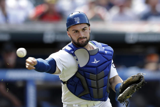 Kansas City Royals' Nick Dini throws out Cleveland Indians' Greg Allen at first base after a bunt in the seventh inning in a baseball game Sunday, Aug. 25, 2019, in Cleveland. (AP Photo/Tony Dejak)