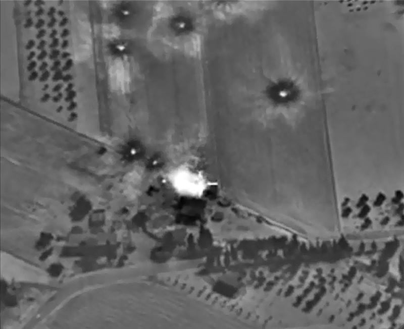 A Russian Defence Ministry website photo purporting to show an airstrike in Syria on October 1, 2015