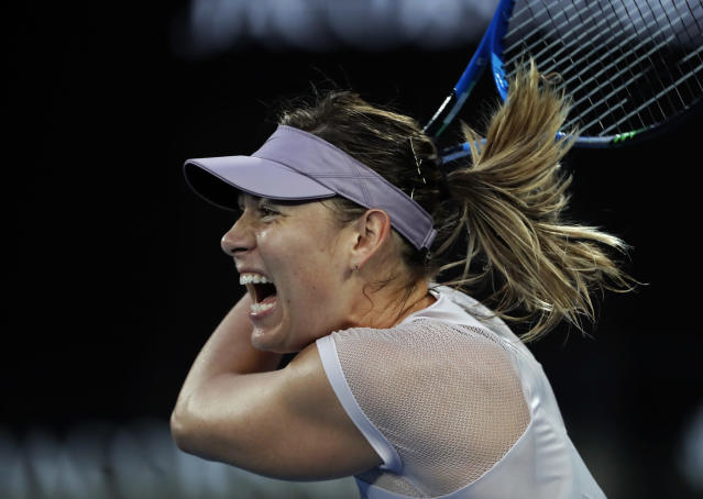 "Russia's Maria Sharapova makes a backhand return to Germany's <a class=""link rapid-noclick-resp"" href=""/olympics/rio-2016/a/1126199/"" data-ylk=""slk:Angelique Kerber"">Angelique Kerber</a> during their third round match at the Australian Open tennis championships in Melbourne, Australia, Saturday, Jan. 20, 2018. (AP Photo/Vincent Thian)"