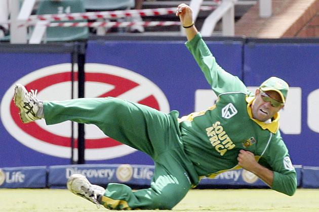 JOHANNESBURG, SOUTH AFRICA - MARCH 12:  Andrew Hall of South Africa dives to catch Adam Gilchrist of Australia during the fifth One Day International between South Africa and Australia played at Wanderers Stadium on March 12, 2006 in Johannesburg, South Africa.  (Photo by Hamish Blair/Getty Images)