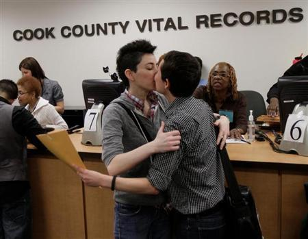Robin Petrovic kisses Jamie Gayle after they received their Civil Union license in Chicago,
