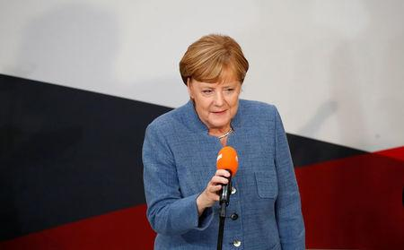 Christian Democratic Union CDU party leader and German Chancellor Angela Merkel gives a speech after winning the German general election (Bundestagswahl) in Berlin, Germany, September 24, 2017. REUTERS/Axel Schmidt