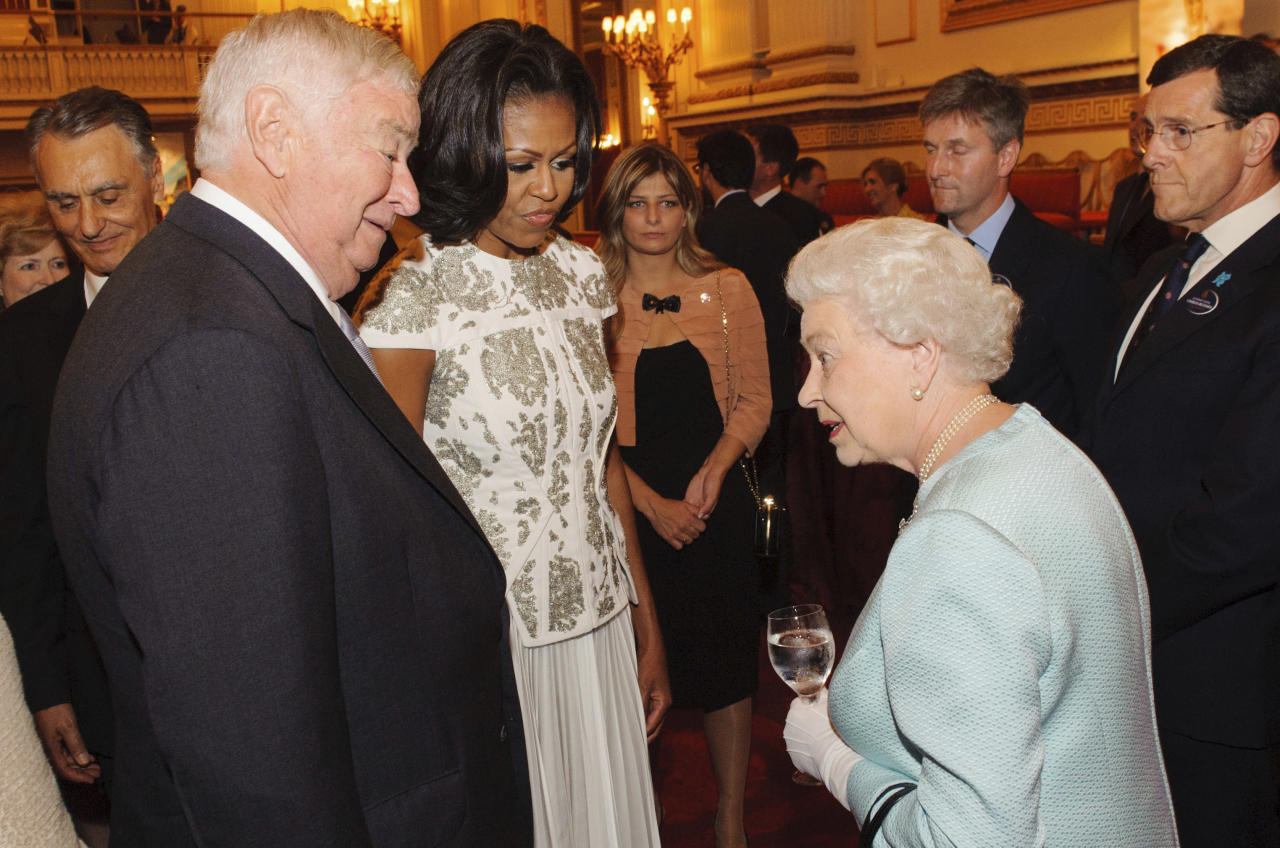 Britain's Queen Elizabeth II talks with U.S. first lady Michelle Obama and US Ambassador Louis Susman at Buckingham Palace in London for a reception hosted by Queen Elizabeth II for the heads of state and government prior to attending the opening ceremony of the London 2012 Olympic Games, Friday, July 27, 2012. (AP Photo/Dominic Lipinski, Pool)