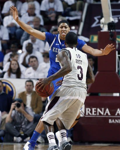 Kentucky forward Anthony Davis awaits Mississippi State guard Dee Bost (3) during the first half of an NCAA college basketball game in Starkville, Miss., Tuesday, Feb. 21, 2012. No. 1 Kentucky won 73-64. (AP Photo/Rogelio V. Solis)