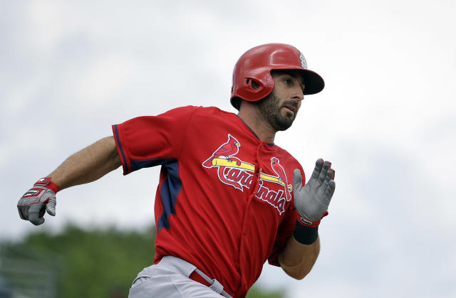 St. Louis Cardinals' Daniel Descalso hits a triple to score teammate Kolten Wong in the first inning of an exhibition spring training baseball game against the Miami Marlins, Tuesday, March 25, 2014, in Jupiter, Fla. (AP Photo/David Goldman)