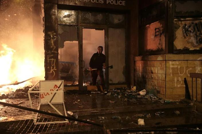 A police building went up in flames in Minnesota during protests (AFP Photo/SCOTT OLSON)