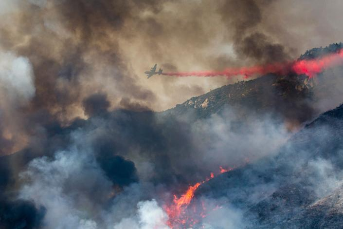 A wildfire burns at a hillside in Yucaipa, Calif., Saturday, Sept. 5, 2020. A brutal heat wave pushed temperatures above 100 degrees in many parts of California over the weekend. (Photo: ASSOCIATED PRESS / Ringo H.W. Chiu)