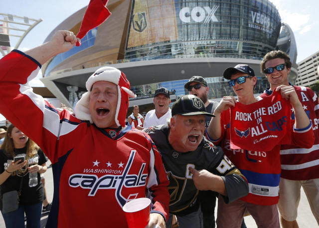 Washington Capitals and Vegas Golden Knights fans cheer outside T-Mobile Arena prior to Game 2 of the NHL hockey Stanley Cup Finals on Wednesday, May 30, 2018, in Las Vegas. (AP Photo/Ross D. Franklin)
