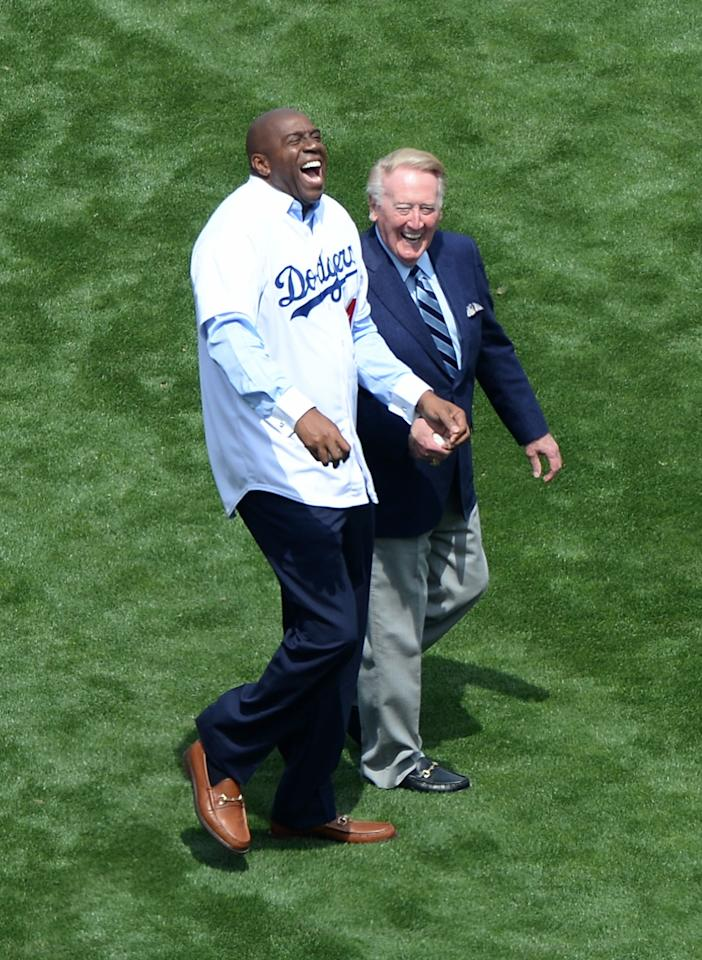 LOS ANGELES, CA - APRIL 04: Magic Johnson and Vin Scully laugh on the field beore the game between the San Francisco Giants and the Los Angeles Dodgers on opening day at Dodger Stadium on April 4, 2014 in Los Angeles, California. (Photo by Harry How/Getty Images)