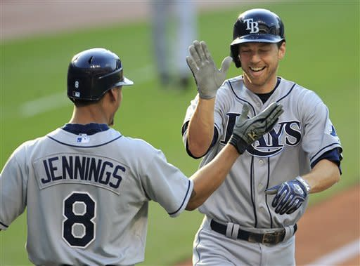Tampa Bay Rays' Ben Zobrist, right, is congratulated by Desmond Jennings after Zobrist hit a two-run home run off Cleveland Indians starting pitcher Justin Masterson in the first inning in a baseball game Friday, July 6, 2012, in Cleveland. Jennings scored. (AP Photo/Tony Dejak)