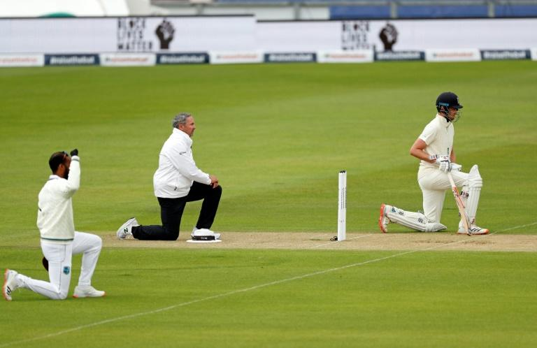 England's Dom Sibley (R) joined team-mates and West Indies players in taking a knee