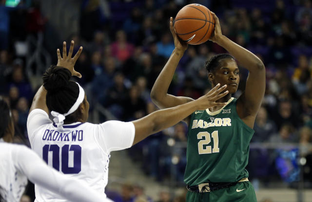 Baylor center Kalani Brown (21) looks to pass as TCU forward Amy Okonkwo (00) defends during the first half of an NCAA college basketball game Saturday, Jan. 12, 2019, in Fort Worth, Texas. (AP Photo/Ron Jenkins)
