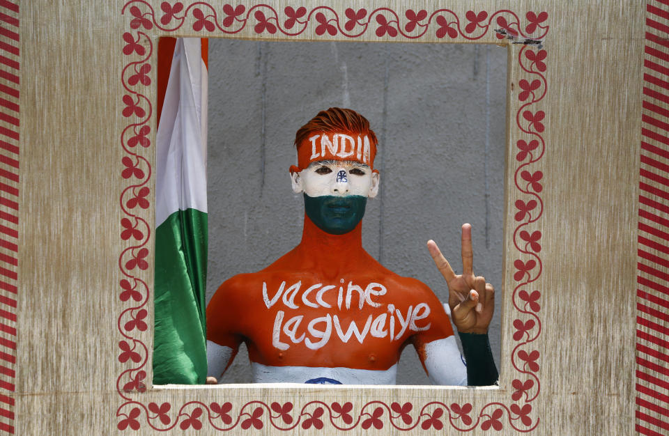 Rajkumar Haryani, 38, poses for photographs after getting a dose of Covishield, Serum Institute of India's version of the AstraZeneca COVID-19 vaccine, in Ahmedabad, India, Saturday, June 12, 2021. Rajkumar painted his body to create awareness about vaccination. (AP Photo/Ajit Solanki)