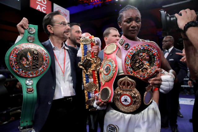 Claressa Shields holds her belts after defeating Christina Hammer by unanimous decision in the women's world middleweight championship boxing bout Saturday, April 13, 2019, in Atlantic City, N.J. (AP Photo/Julio Cortez)