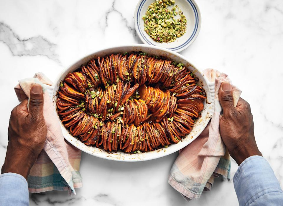 """The classic savory-sweet side gets a makeover with the addition of harissa for an extra hint of spicy-earthiness. We promise you won't miss the marshmallows. <a href=""""https://www.bonappetit.com/recipe/shingled-sweet-potatoes-with-harissa?mbid=synd_yahoo_rss"""" rel=""""nofollow noopener"""" target=""""_blank"""" data-ylk=""""slk:See recipe."""" class=""""link rapid-noclick-resp"""">See recipe.</a>"""