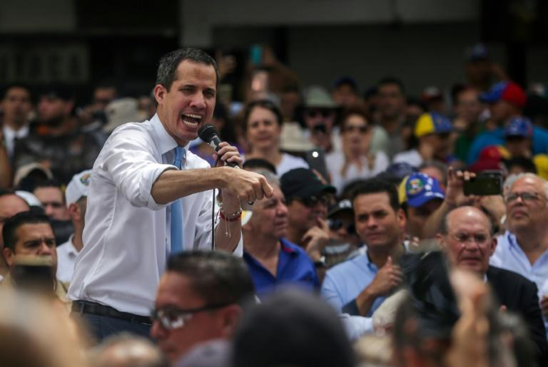 Juan Guaido addresses supporters during a march blocked by police in Caracas on Tuesday (AFP Photo/CRISTIAN HERNANDEZ)