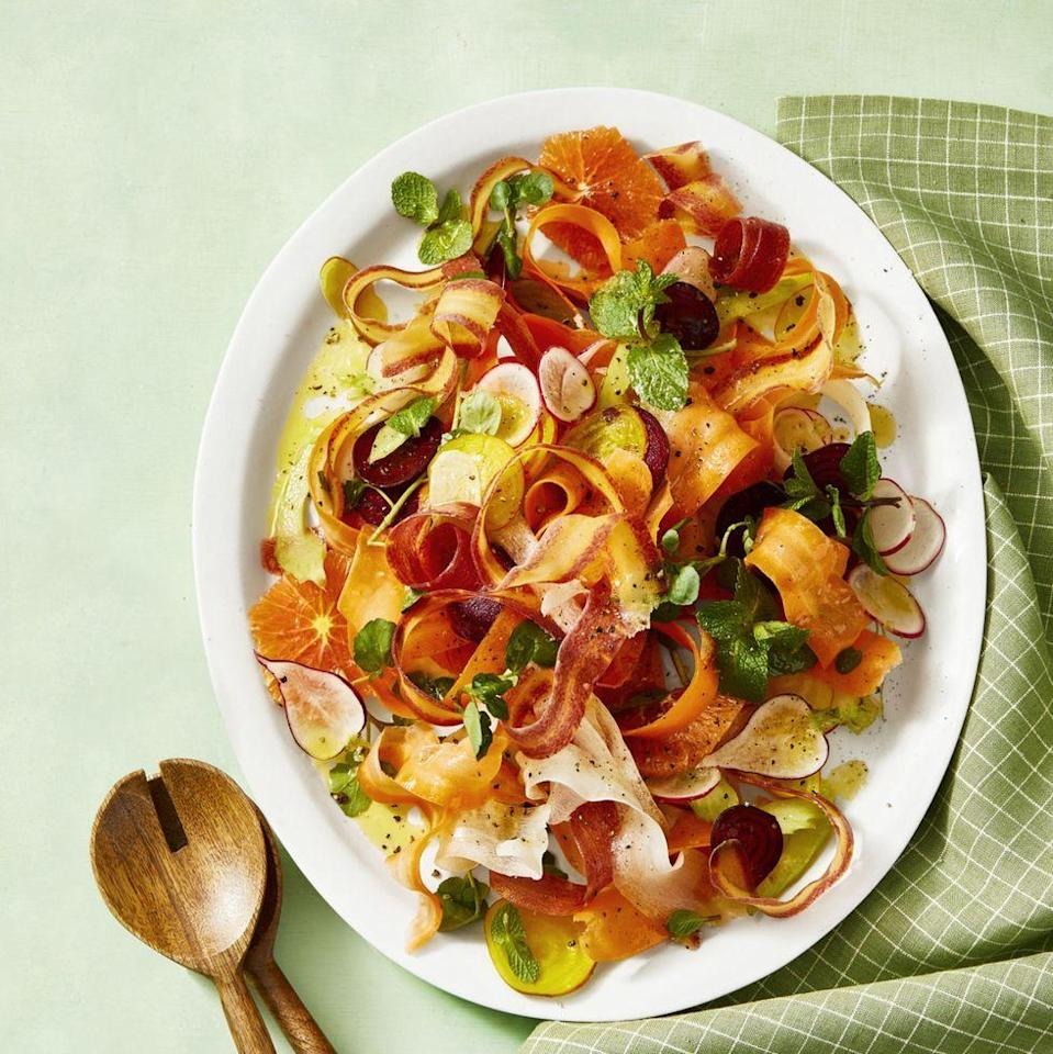 """<p>Beautiful carrot ribbons and thinly sliced radishes get dressed in a sweet-tart honey citrus vinaigrette for the prettiest salad ever.</p><p><em><a href=""""https://www.goodhousekeeping.com/food-recipes/healthy/a30729726/shaved-carrot-salad-recipe/"""" rel=""""nofollow noopener"""" target=""""_blank"""" data-ylk=""""slk:Get the recipe for Shaved Carrot and Radish Salad »"""" class=""""link rapid-noclick-resp"""">Get the recipe for Shaved Carrot and Radish Salad »</a></em></p><p><strong>RELATED: </strong><a href=""""https://www.goodhousekeeping.com/food-recipes/healthy/g180/healthy-salads/"""" rel=""""nofollow noopener"""" target=""""_blank"""" data-ylk=""""slk:37 Delicious Healthy Salads That Are Fresh and Filling"""" class=""""link rapid-noclick-resp"""">37 Delicious Healthy Salads That Are Fresh and Filling</a></p>"""