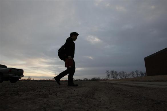 Davy Lin, a foreign exchange student from Taoyuan, Taiwan walks to class at Grant-Deuel School in Revillo, South Dakota, February 15, 2012.