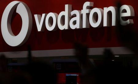 FILE PHOTO: The Vodafone logo is seen at the Mobile World Congress in Barcelona, Spain, February 28, 2018. REUTERS/Sergio Perez