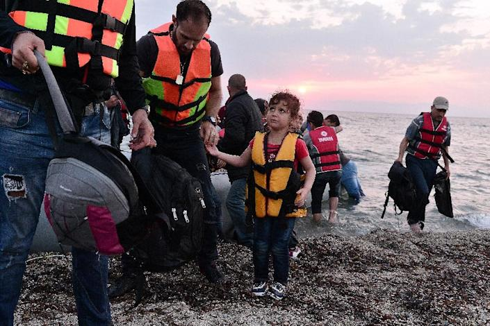 Syrian migrants disembark on the Greek island of Lesbos, early on June 18, 2015 (AFP Photo/Louisa Gouliamaki)