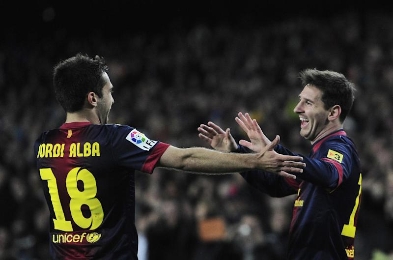 FC Barcelona's Lionel Messi, from Argentina, right, celebrates with his teammate Jordi Alba after scoring against Rayo Vallecano during a Spanish La Liga soccer match at the Camp Nou stadium in Barcelona, Spain, Sunday, March 17, 2013. (AP Photo/Manu Fernandez)
