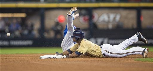 Milwaukee Brewers' Jean Segura steals second as Chicago Cubs' Darwin Barney tries to make catch from Wellington Castillo during the fourth inning of an MLB National League baseball game Sunday, April 21, 2013, in Milwaukee. Castillo was charged with an error on the play. (AP Photo/Tom Lynn)