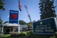 CORRECTS TO FUNERAL HOME VIEWING INSTEAD OF FUNERAL Long Island firefighters attend the funeral home viewing of Gabby Petito at Moloney's Holbrook Funeral Home in Holbrook, N.Y. Sunday, Sept. 26, 2021. (AP Photo/Eduardo Munoz Alvarez)