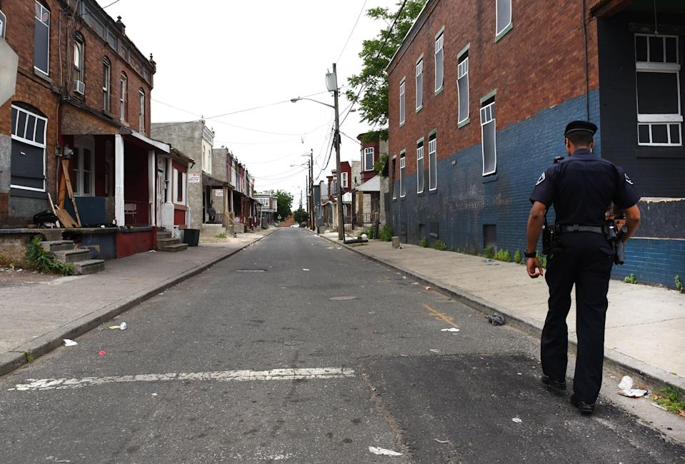 Camden County Police Department officer Jose Delvalle is seen on foot patrol in Camden, New Jersey, on May 24, 2017. In 2013 the city of Camden, New Jersey, dissolved its police force, replacing it with a new county-run department where they are turning around a city that had one of the highest crime rates in the country. (TIMOTHY A. CLARY/AFP via Getty Images)